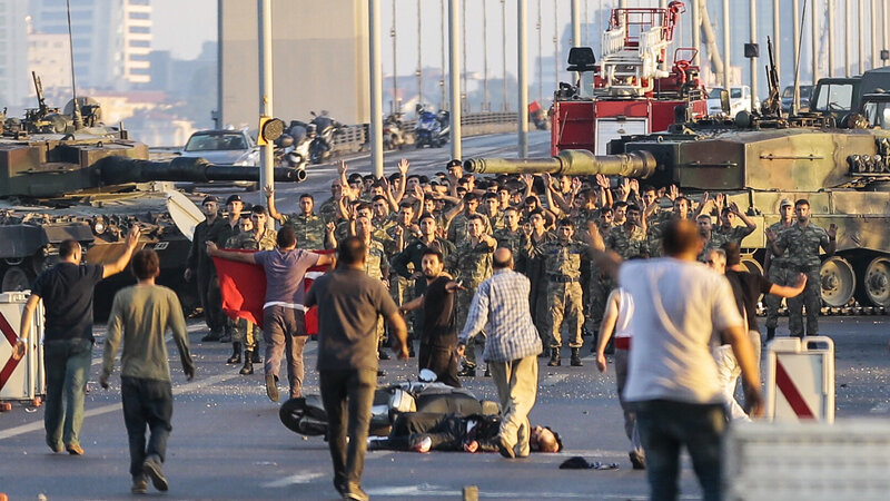 Turkish soldiers involved in a coup attempt raise their hands in surrender Saturday on the bridge that crosses Istanbul's Bosphorus Strait. Turkey's government reestablished control Saturday and declared the coup a failure. More than 250 were killed and more than 1,400 wounded in the fighting.