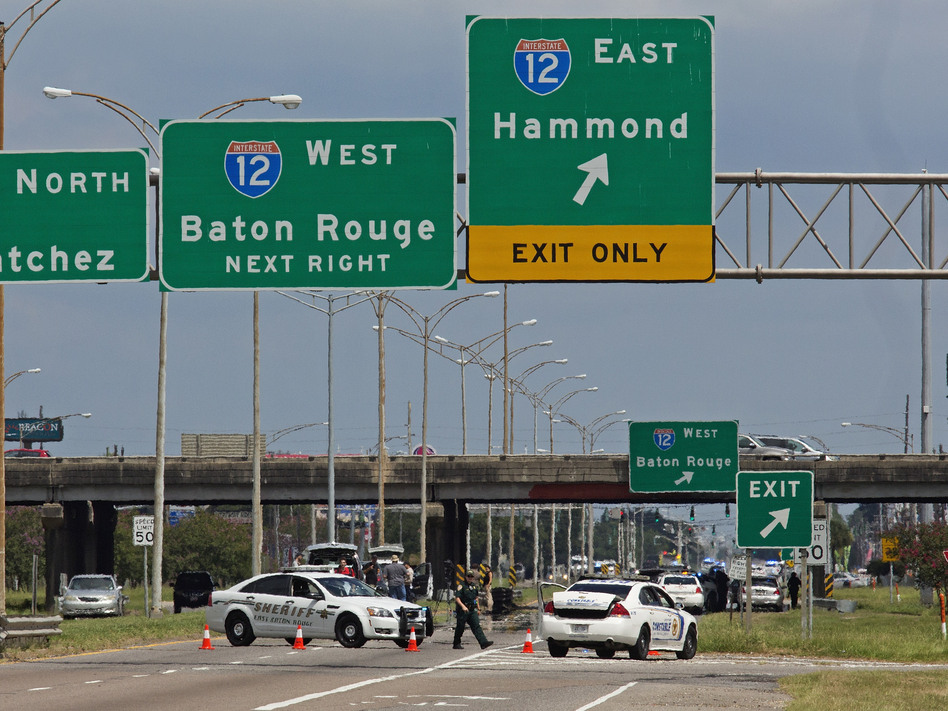 Baton Rouge police block Airline Highway after police were shot in Baton Rouge, La., on Sunday. Several law enforcement officers were killed and several injured in a shooting in Baton Rouge on Sunday morning. (Max Becherer/AP)