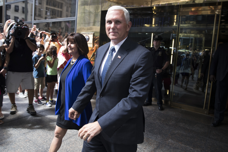 Pence and his wife, Karen, leave a meeting with Trump in New York on Friday. (Evan Vucci/AP)