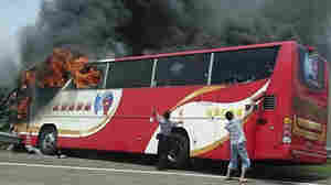 A tour bus carrying visitors from China burst into flames on a busy highway near the Taiwanese capital, Taipei, on Tuesday. Officials said all 26 people onboard died.