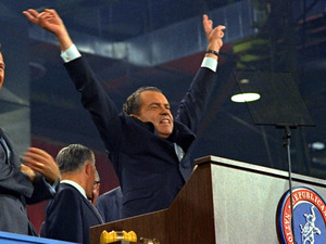 Republican presidential nominee Richard Nixon signals V for victory after accepting his party's nomination at the Republican convention in Miami on Aug. 8, 1968.