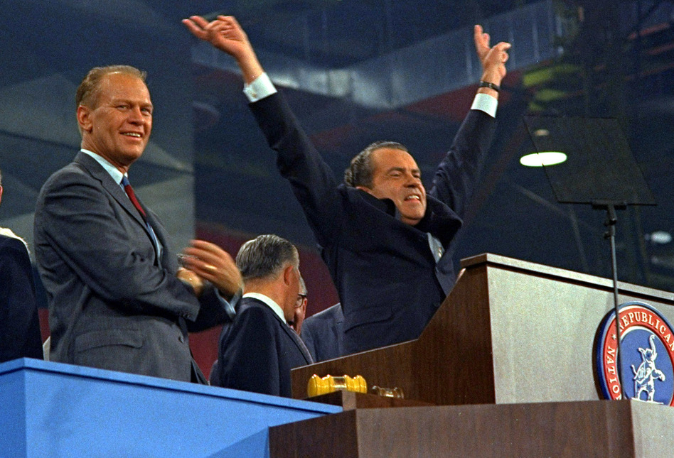 Republican presidential nominee Richard Nixon signals V for victory after accepting his party's nomination at the Republican convention in Miami on Aug. 8, 1968. (AP)