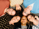 Mike Birbiglia (clockwise from left), Kate Micucci, Chris Gethard, Gillian Jacobs, Keegan-Michael Key and Tami Sagher play members of the improv comedy group the Commune in <em>Don't Think Twice.</em>