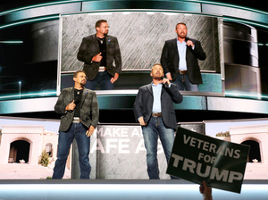 U.S. Marine Corps veterans John Tiegen (left) and Mark Geist deliver a speech on the first day of the Republican National Convention on Monday.