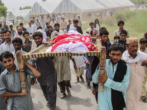 Friends and family carry Pakistani social media celebrity Qandeel Baloch's body at her funeral.