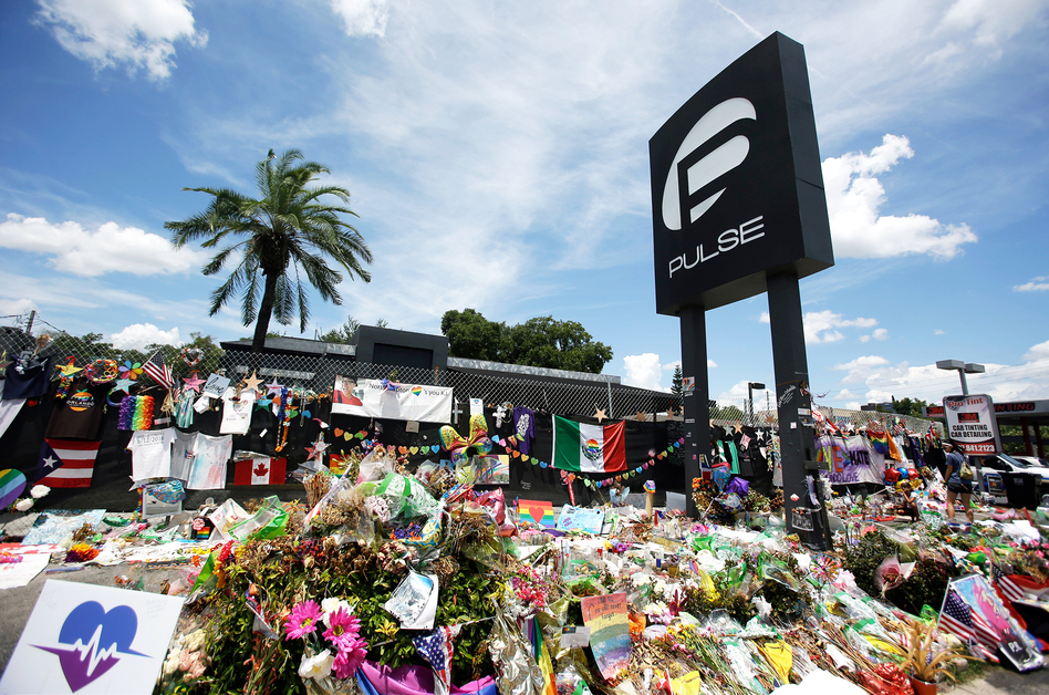 A makeshift memorial continues to grow outside the Pulse nightclub in Orlando, Fla., on July 11, one month after the mass shooting at the club. (John Raoux/AP)