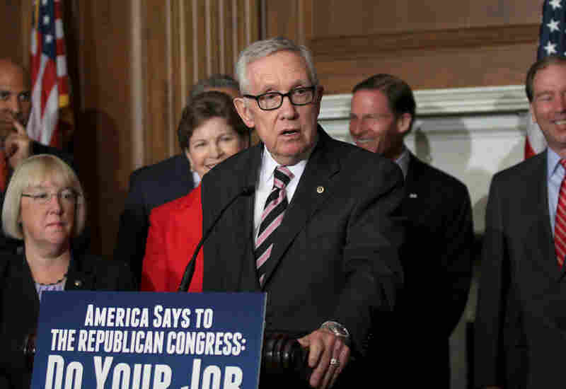 Senate Minority Leader Harry Reid of Nev. speaks to reporters on Capitol Hill in Washington, Thursday, July 14, 2016, to discuss unfinished business before Congress prior to its recess. Congress is about to leave for a seven-week vacation without giving the Obama administration any of the $1.9 billion it's seeking to battle the Zika virus.