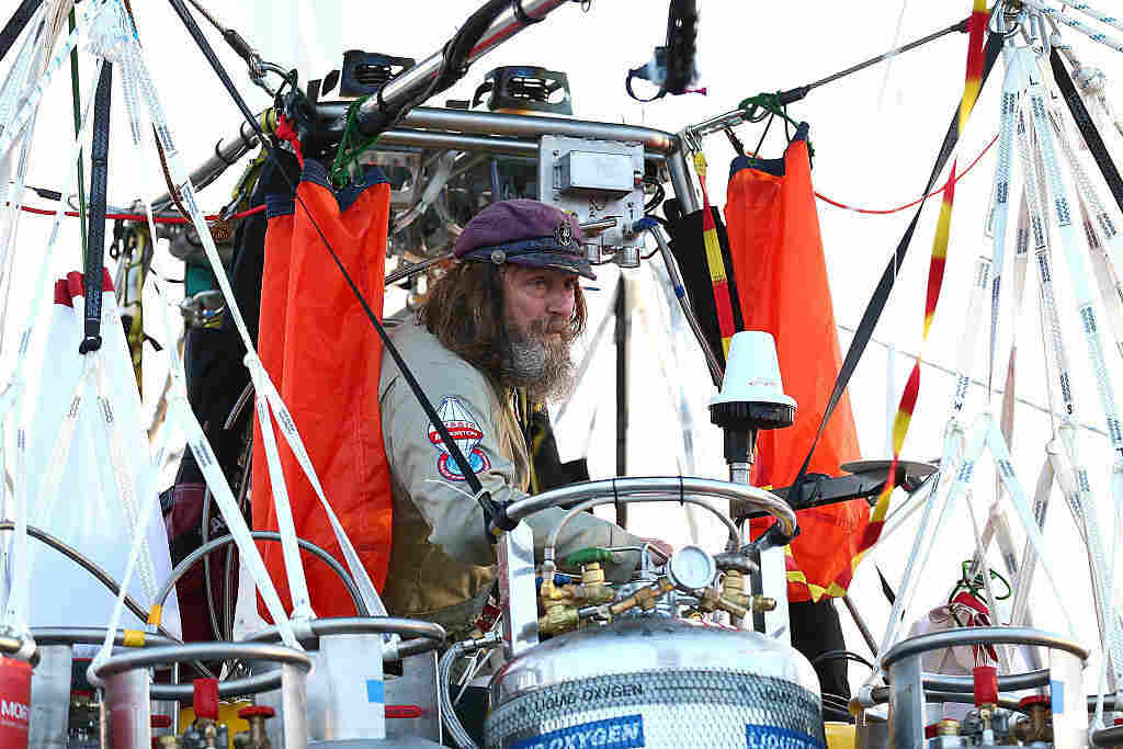 Fedor Konyukhov prepares for liftoff from the Northam Aero Club on July 12 in Northam, Australia. For the past eight days, he has had little sleep in an open gondola hurtling at high speeds through below-freezing air that is too thin to breathe.