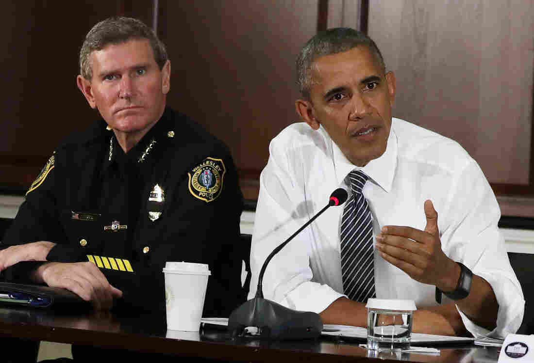 President Obama speaks as Terry Cunningham International Association of Chiefs of Police listens July 13 during a conversation on community policing and criminal justice at the Eisenhower Executive Office Building in Washington.