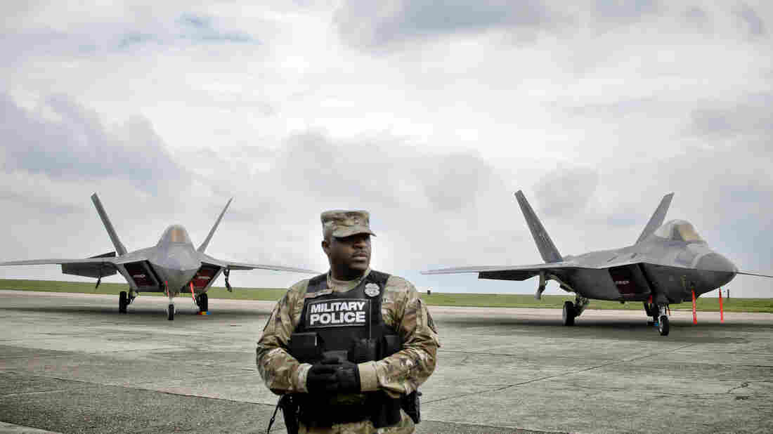 A U.S. military policeman stands in front of Air Force fighter jets that were were part of a NATO show of strength in Romania in April intended to deter Russian intervention in Ukraine.