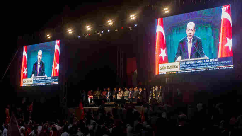 Video screens Wednesday night in Istanbul's Taksim Square show President Recep Tayyip Erdogan as he announced a three-month state of emergency following last Friday's failed coup.