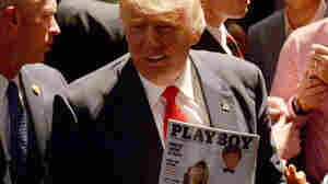 Republican presidential nominee Donald Trump shows a police officer his photo on the cover of a Playboymagazine during a campaign event at the Duke Energy Center for the Performing Arts on July 5 in Raleigh, N.C.