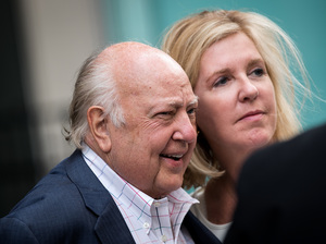 Fox News CEO and Chairman Roger Ailes and his wife, Elizabeth Tilson, leave the News Corp. building in New York on Tuesday. Ailes is stepping down from his role and Rupert Murdoch will be taking over as chairman and acting CEO.