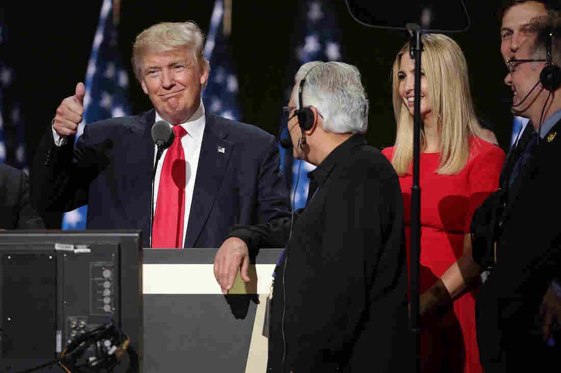 Republican presidential candidate Donald Trump and his daughter Ivanka test the teleprompters and microphones on stage before the start of the final day of the Republican National Convention.
