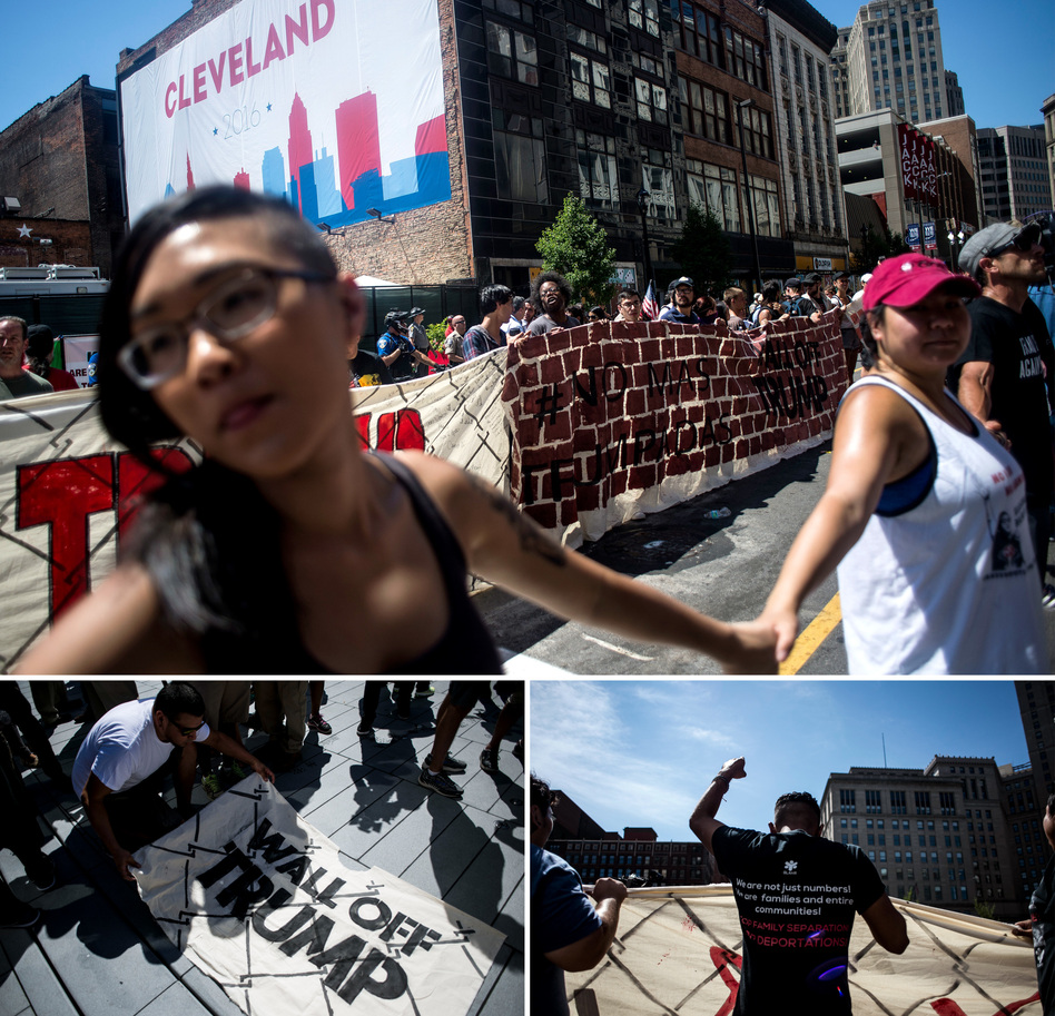 Organizers from Mijente, Georgia Latino Alliance for Human Rights, Ruckus Society and other activist organizations stage a protest and march outside Quicken Loans Arena in Cleveland. (Gabriella Demczuk for NPR)