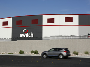 A car drives by a Switch data center in Las Vegas on Sept. 9, 2015. In 2013, data centers consumed 2 percent of all U.S. power — triple what they used in 2000.