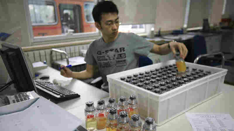 New analysis of stored samples taken from athletes at the Beijing and London Summer Olympics has turned up 45 cases of banned substances. Here, urine samples are recorded upon arriving at the China Anti-Doping Agency in Beijing in 2008.