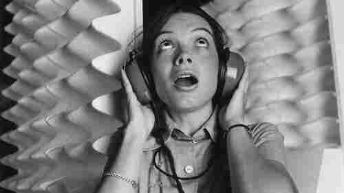 A woman wearing headphones in 1971