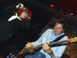 Exene Cervenka and John Doe perform in Hollywood in September 2004.