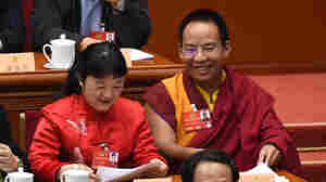 The Chinese government-selected Panchen Lama, Gyaincain Norbu (right), took part in the Chinese People's Political Consultative Conference in Beijing on March 14.