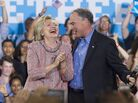 Democratic Presidential candidate Hillary Clinton and Sen. Tim Kaine laugh at a campaign rally in Annandale, Virginia, on July 14.