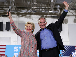 Democratic presidential candidate Hillary Clinton and Sen. Tim Kaine of Virginia greet the crowd during a campaign event on July 14 in Annandale, Va.