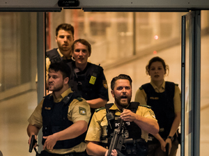 Police officers respond to a shooting at the Olympia Einkaufszentrum shopping center on Friday in Munich.