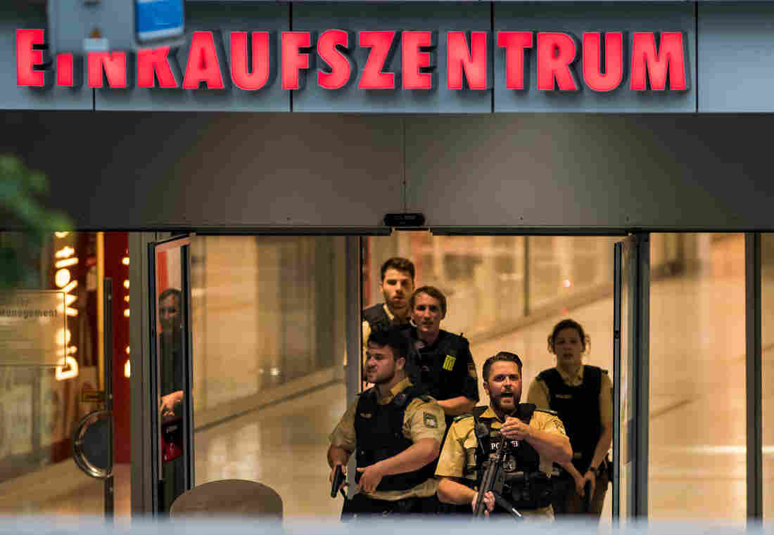 Police officers respond to a shooting at the Olympia Einkaufzentrum shopping center on Friday in Munich, Germany.