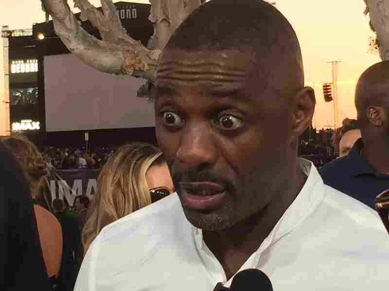 Idris Elba, who plays the villain Krall: evidently concerned that Nina's choking on a soft pretzel.