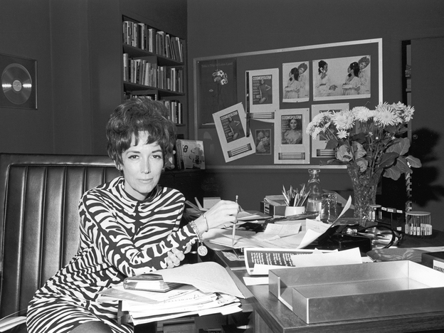 """Helen Gurley Brown in her office at <em>Cosmopolitan</em> magazine in the 1960s .The legendary editor, subject of two new biographies, knew sex sells – and food brings in ad money. She cannily combined them with features like """"After Bed, What? (a light snack for an encore)."""""""
