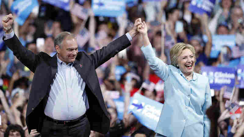 Democratic presidential candidate Hillary Clinton arrives with Sen. Tim Kaine at a rally at Florida International University Saturday.