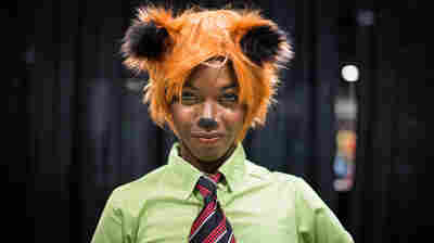 Makeba Hinds, also known as Maki Roll, cosplays at AwesomeCon. She portrays Nick, the fox in Zootopia.