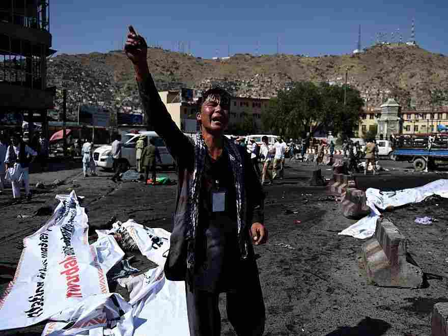 An Afghan protester screams near the scene of a suicide attack that targeted crowds of minority Shiite Hazaras during a demonstration in Kabul on Saturday.