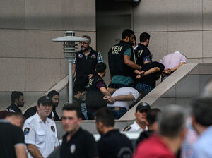 Detained Turkish soldiers who allegedly took part in a military coup arrive with their hands bound behind their backs at the Istanbul Justice Palace on Wednesday following the failed military coup attempt.