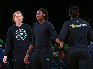 Carolyn Swords (left) and Tina Charles (right) of the New York Liberty look on before the game against the Indiana Fever on Thursday at Madison Square Garden in New York, New York. Charles says she turned her warmup shirt inside out in support of recent shooting victims.