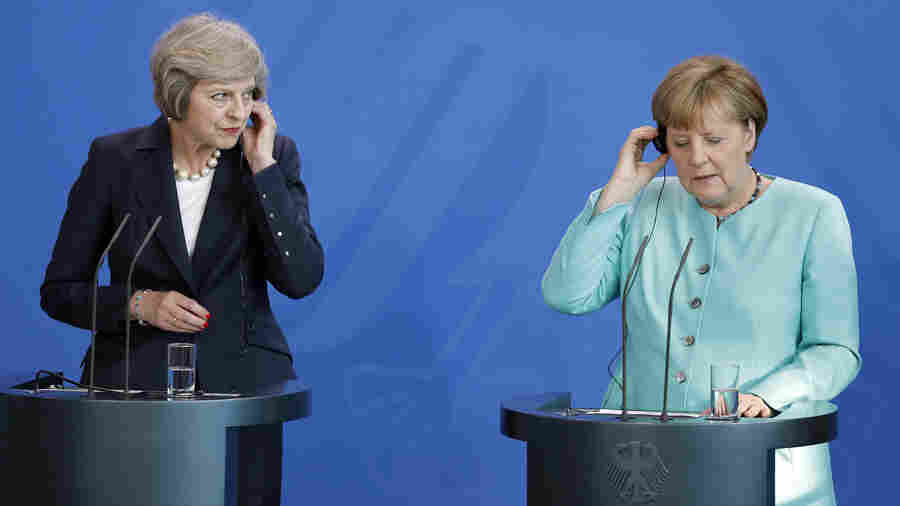 German Chancellor Angela Merkel (right), and British Prime Minister Theresa May (left), listen to translations during a joint news conference in Berlin on July 20. They are the two most important figures in the negotiations over Britain's departure from the European Union, the so-called Brexit.
