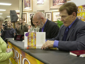 "Tim LaHaye (right) and Jerry B. Jenkins sign the 12th book in the ""Left Behind"" series in 2004 at a store in Spartanburg, S.C."