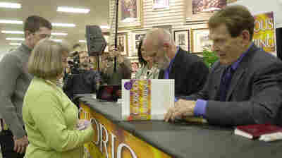 Tim LaHaye (right) and Jerry B. Jenkins sign the 12th book in the Left Behind series at a store in Spartanburg, S.C., in 2004.