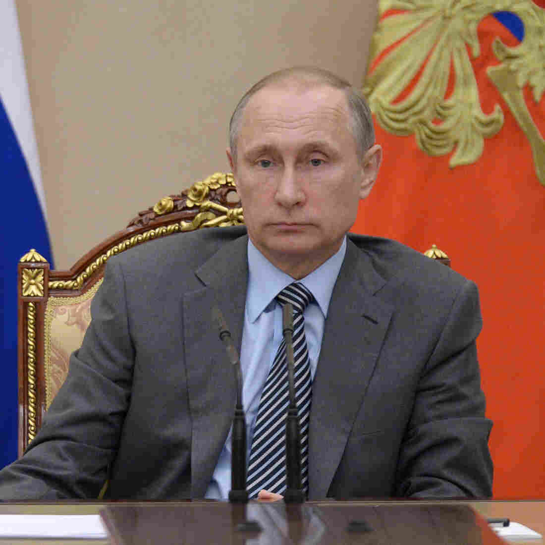 Russian President Vladimir Putin chairs a recent meeting of Russia's Cabinet in the Kremlin. Security experts say Russia is behind the DNC hack.