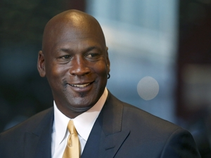 Michael Jordan says he is giving a million dollars each to an NAACP legal fund and a community policing group to help find solutions to violence against African Americans and police officers.