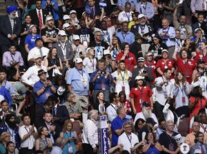 Delegates stand during the national anthem at the opening of the Democratic National Convention.