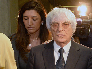 The mother of Fabiana Flosi, seen here with her husband, Formula One racing Bernie Ecclestone, has reportedly been kidnapped in Brazil. Flosi and Ecclestone are seen here in 2014, after a court proceeding in Germany.