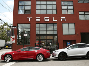 Tesla vehicles sit parked outside a new Tesla showroom and service center in Brooklyn, New York on July 5. The electric car company has come under increasing scrutiny following a crash of one of its electric cars while using the controversial Autopilot feature.