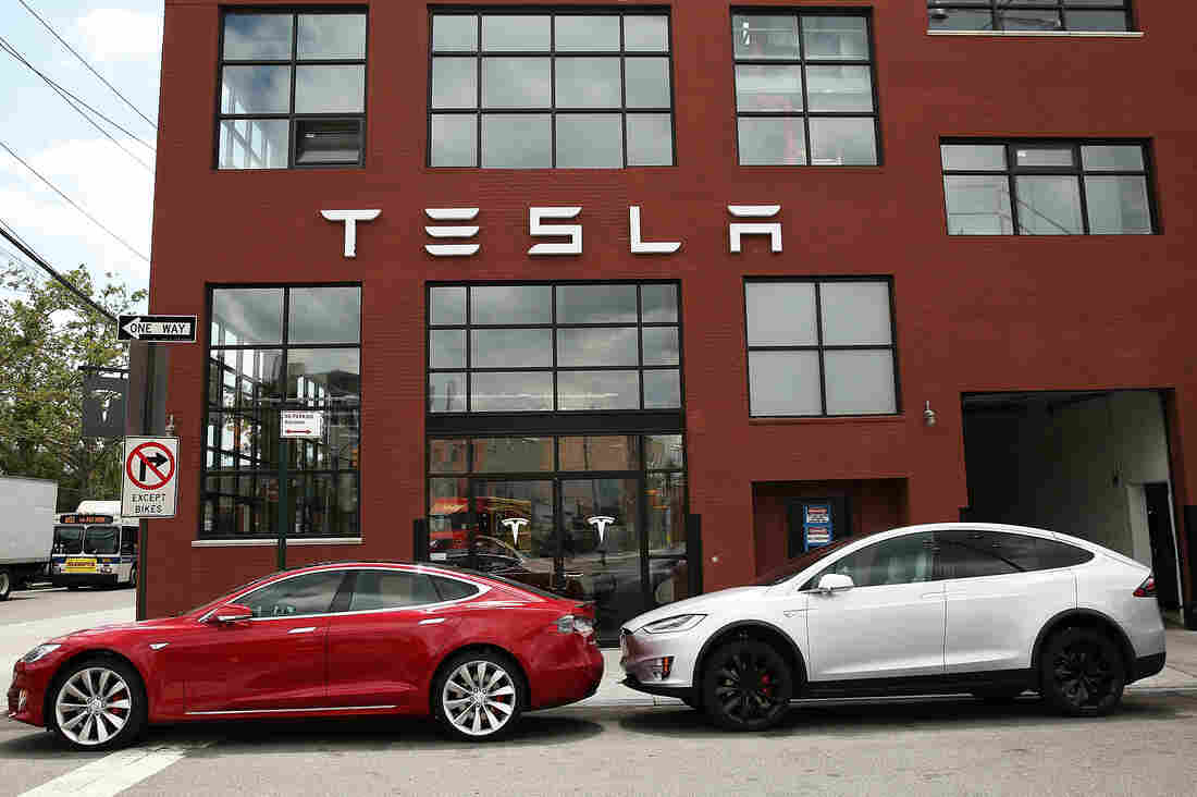 Tesla vehicles sit parked outside of a new Tesla showroom and service center in Brooklyn, New York on July 5. The electric car company has come under increasing scrutiny following a crash of one of its electric cars while using the controversial Autopilot feature.