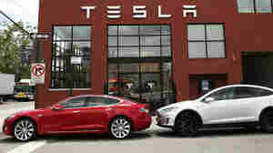 Tesla vehicles sit parked outside of a new Tesla showroom and service center in Red Hook, Brooklyn on July 5. The electric car company has come under increasing scrutiny following a crash of one of its electric cars while using the controversial autopilot service.