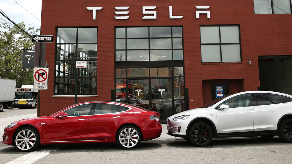 Tesla vehicles sit parked outside a new Tesla showroom and service center in Brooklyn, New York on July 5. The electric car company has come under increasing scrutiny following a crash of one of its electric cars while using the controversial Autopilot feature. (Getty Images)