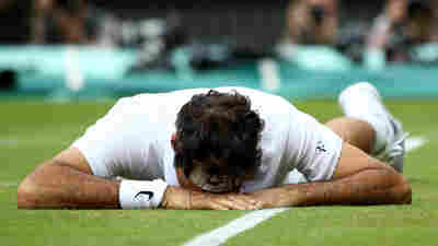 Roger Federer of Switzerland reacts after he slips during the men's singles semifinal match on July 8, during Wimbledon, in London.