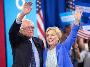 Presumptive Democratic presidential candidate Hillary Clinton and Bernie Sanders wave after speaking at a rally in Portsmouth, N.H. earlier this month.