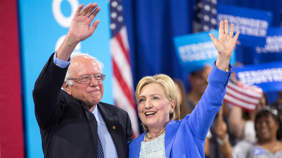 Presumptive Democratic presidential candidate Hillary Clinton and Bernie Sanders wave after speaking at a rally in Portsmouth, N.H. earlier this month. (AFP/AFP/Getty Images)