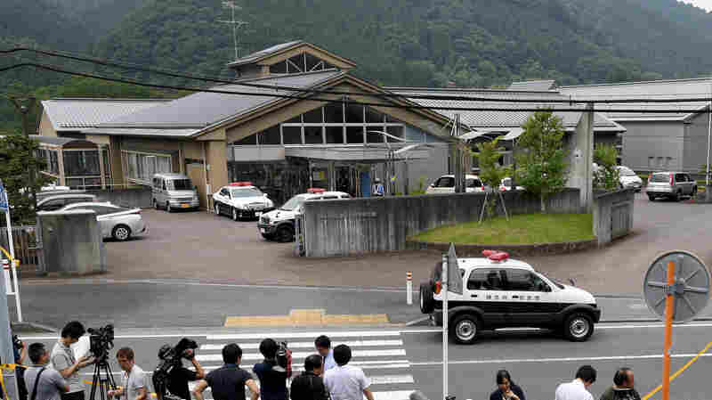 Journalists gather at the main gate of a care center where a knife-wielding man went on a rampage in the city of Sagamihara, west of Tokyo on Tuesday.